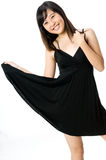 Girl In Black Dress. A young Asian woman wearing black dress on white background Stock Photo