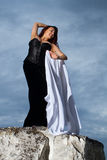 Girl in a black dress Stock Image
