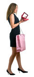 Girl in black dress with the big pink bag Royalty Free Stock Images