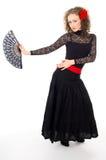 Girl in black dress dancing carmen Stock Photography