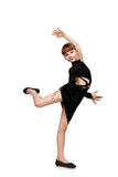 Girl in a black dress dancing Stock Photo