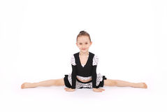 Girl in black dress doing splits Stock Image