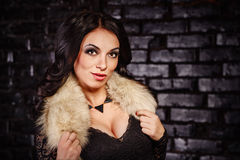 Girl in a black dress and furs Royalty Free Stock Image
