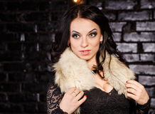 Girl in a black dress and furs Royalty Free Stock Images