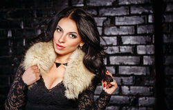 Girl in a black dress and furs Stock Image