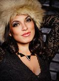 Girl in a black dress and furs Royalty Free Stock Photography