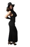 Girl in a black dress and a hat Royalty Free Stock Photo