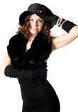 Girl in a black dress and a hat Royalty Free Stock Photos