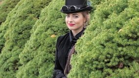Girl in a black dress and hat in autumn. 2019 stock video
