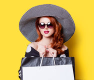 Girl in black dress and hat with shopping bags Stock Photo