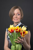 Girl in black dress holding tulips Royalty Free Stock Photography