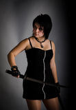 Girl in a black dress with a katana Stock Image