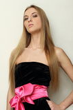 Girl in black dress with pink bow Royalty Free Stock Image
