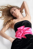Girl in black dress with pink bow Royalty Free Stock Photos
