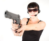 Girl in black dress with pistol. Sexi girl in black dress with pistol and headphones Royalty Free Stock Photos