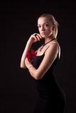 Girl in black dress with red rose Stock Photography