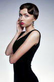The girl in black dress. A girl in a black dress with sad eyes Royalty Free Stock Photography