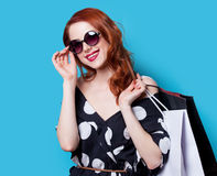 Girl in black dress with shopping bags Royalty Free Stock Image