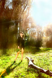 Girl in black dress on summer sunny meadow forest Stock Photo