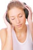 Girl in black ear-phones Stock Photography