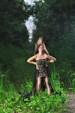 Girl in a black evening dress in the wood Royalty Free Stock Image