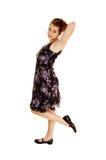 Girl in black flowered dress. Stock Photo