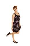 Girl in black flowered dress. Royalty Free Stock Image