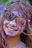Girl in Black Framed Sunglasses With Color on Her Face from Color Run Smiling Stock Photography