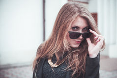 Girl in black glasses Royalty Free Stock Photography