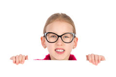 Girl in black glasses behind white placard Stock Images