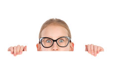 Girl in black glasses behind white placard Stock Photos
