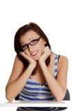 Girl with black glasses sitting and smiling. Stock Photo