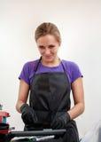 The girl in black gloves hairdresser mixes hair dye. Stock Photo