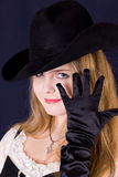 Girl in black gloves and a hat Stock Photos