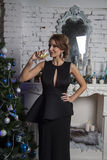 Girl in black gown with champagne goblet Stock Photos