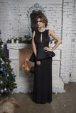 Girl in black gown. new year celebration Royalty Free Stock Images