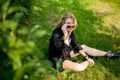 Girl in black on the grass Stock Images