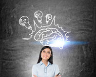 Girl with black hair and brain with light bulbs Royalty Free Stock Photography