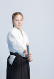 A girl in black hakama standing in fighting pose Royalty Free Stock Photography