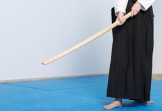 A girl in black hakama standing in fighting pose with wooden sword Stock Photos
