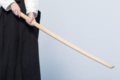 A girl in black hakama standing in fighting pose with wooden sword Royalty Free Stock Photography