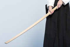 A girl in black hakama standing in fighting pose with wooden sword bokken Stock Photography