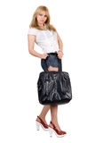 Girl with a black handbag royalty free stock photos