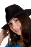 Girl in black hat Stock Photos