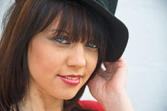 Girl in black hat. An image of a pretty young woman wearing a black hat Stock Photography