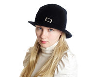 Girl in a black hat. Portrait of blue-eyed girl in a black hat Royalty Free Stock Images