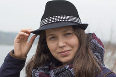 Girl with a black hat Stock Images
