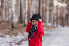 Girl in a black hat with ears, walks in the park cold spring day Stock Image