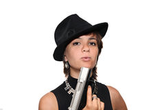 Girl in black hat with a gun. Young girl in a black hat holding handgun Royalty Free Stock Photos