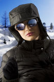 Girl with black hat and sunglasses Stock Image